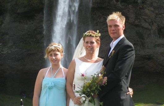 Bride and groom in front of waterfall