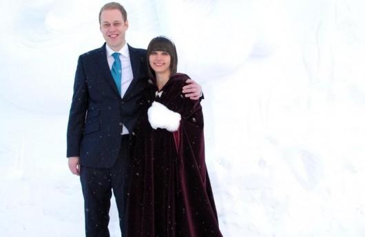 Bride and groom in winter wedding cape