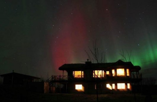 Northern Lights over House in Iceland